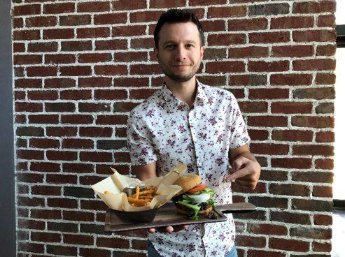 Magician Mat Franco poses (Photo Courtesy of Smoked Burgers & BBQ)